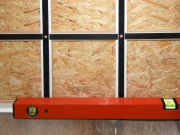 Align the bottom profile with a spirit level.